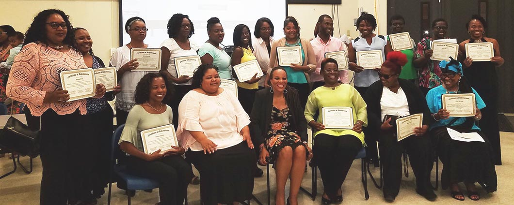Group shot of a class with their diplomas